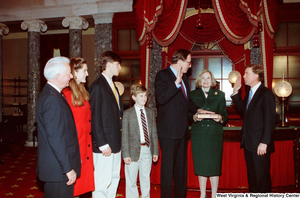 "[""Senator John D. (Jay) Rockefeller is sworn in for his second term as Senator from West Virginia. Vice President Dan Quayle administers the oath, Sharon Rockefeller holds the bible, and Senator Robert C. Byrd can be seen standing with Senator Rockefeller's children.""]%"