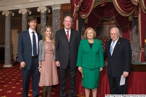 "[""Senator John D. (Jay) Rockefeller stands with his wife, one of his sons, and Vice President Dick Cheney after his Senate Swearing-In Ceremony.""]%"