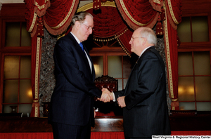"[""Senator John D. (Jay) Rockefeller shakes hands with Vice President Dick Cheney after taking the oath of office for his fourth term.""]%"