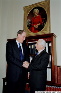 "[""After being sworn into his fourth term, Senator John D. (Jay) Rockefeller shakes hands with Senator Robert C. Byrd.""]%"