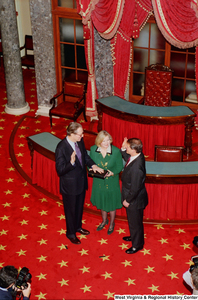 "[""This aerial shot shows Senator John D. (Jay) Rockefeller being sworn into his third term.""]%"