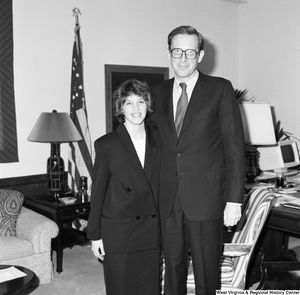 "[""Senator John D. (Jay) Rockefeller stands for a photograph with an unidentified woman in his office.""]%"