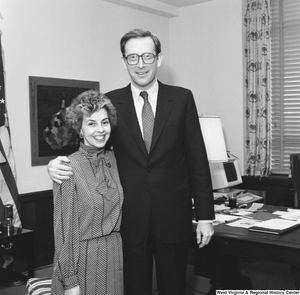 "[""Senator John D. (Jay) Rockefeller stands with an unidentified woman for a photograph in his office.""]%"