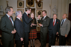 "[""Surrounded by colleagues Senator Robert C. Byrd, Senator Bob Dole, Senator Strom Thurmond, and former Senator Jennings Randolph, Vice President administers the oath of office for Senator John D. (Jay) Rockefeller.""]%"