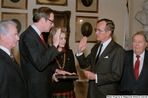 "[""Photograph of Vice President George H. W. Bush administering the oath to Senator John D. (Jay) Rockefeller.""]%"