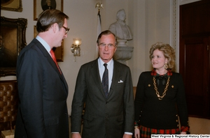 "[""Photograph of Senator Rockefeller with Vice President George H.W. Bush and Sharon Rockefeller at the Senate Ceremonial Swearing-In""]%"