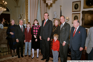 "[""Senator John D. (Jay) Rockefeller stands with family and colleagues at Senate Swearing-In Ceremony.""]%"