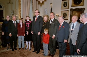 "[""Senator John D. (Jay) Rockefeller is photographed with family, Senate colleagues Robert C. Byrd, Strom Thurmond, and Jennings Randolph, and Vice President George H. W. Bush after taking the oath of office at the Senate swearing-in ceremony.""]%"