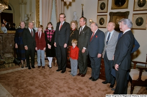 "[""Colleagues including Senators Robert C. Byrd, Strom Thurmond, and Jennings Randolph, Vice President George H. W. Bush, and family surround Senator John D. (Jay) Rockefeller at the Senate swearing-in ceremony. (wider angle image)""]%"