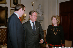 "[""Senator John D. (Jay) Rockefeller with Vice President George H. W. Bush and Sharon Rockefeller at the Senate Swearing-In ceremony.""]%"