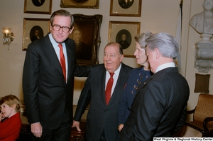 "[""Former Senator Jennings Randolph and Senator Robert C. Byrd gather with Senator John D. (Jay) Rockefeller at the Senate swearing-in ceremony.""]%"