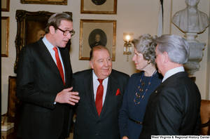 "[""Senator John D. (Jay) Rockefeller speaks with Senator Robert C. Byrd and former Senator Jennings Randolph after the Senate Swearing-In Ceremony.""]%"