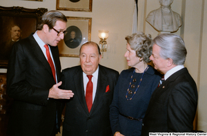 "[""Senator John D. (Jay) Rockefeller speaks with Senate colleagues after the Senate Swearing-In Ceremony.""]%"