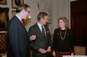 "[""Senator John D. (Jay) Rockefeller with wife Sharon Rockefeller and Vice President George H. W. Bush at the Senate Swearing-In Ceremony.""]%"