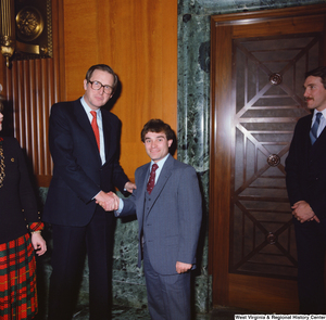 "[""Senator John D. (Jay) Rockefeller greets an unidentified individual following the Senate Swearing-In Ceremony.""]%"
