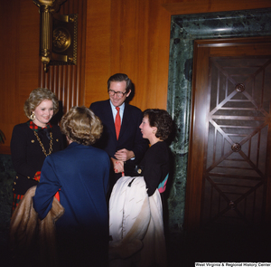 "[""Senator John D. (Jay) Rockefeller and wife Sharon greet unidentified individuals following the Senate Swearing-In Ceremony.""]%"