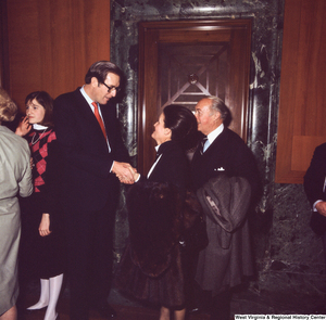 "[""Senator John D. (Jay) Rockefeller speaks with unidentified supporters following the Senate Swearing-In Ceremony.""]%"