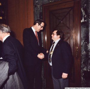 "[""Senator John D. (Jay) Rockefeller shakes hands with an unidentified supporter following the Senate Swearing-In Ceremony.""]%"
