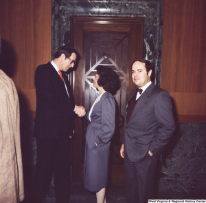"[""Senator John D. (Jay) Rockefeller shakes hands with unidentified individuals after the Senate Swearing-In Ceremony.""]%"