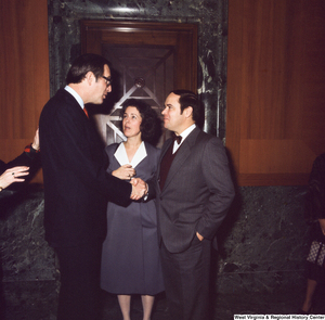 "[""Unidentified supports shake hands and speak with Senator John D. (Jay) Rockefeller following his Senate Swearing-In Ceremony.""]%"