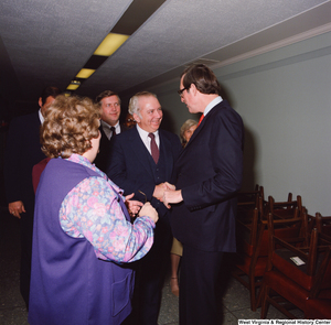 "[""Senator John D. (Jay) Rockefeller is greeted by unidentified supporters following the Senate Swearing-In Ceremony.""]%"