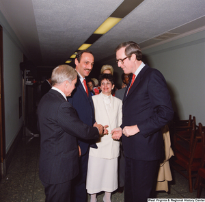 "[""Senator John D. (Jay) Rockefeller speaks with unidentified supporters following his Senate Swearing-In Ceremony.""]%"