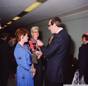 "[""Unidentified supporters speak with Senator John D. (Jay) Rockefeller following his Senate Swearing-In Ceremony.""]%"