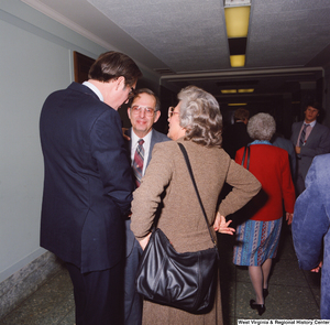 "[""Senator John D. (Jay) Rockefeller speaks with two unidentified individuals following his Senate Swearing-In Ceremony.""]%"