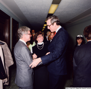 "[""Senator John D. (Jay) Rockefeller shakes hands with an unidentified individual following the Senate Swearing-In Ceremony.""]%"