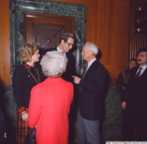 "[""Following the Senate Swearing-In Ceremony, Senator John D. (Jay) Rockefeller and his wife Sharon chat with unidentified supporters.""]%"