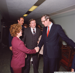 "[""Senator John D. (Jay) Rockefeller greets unidentified supporters after his Senate Swearing-In Ceremony.""]%"