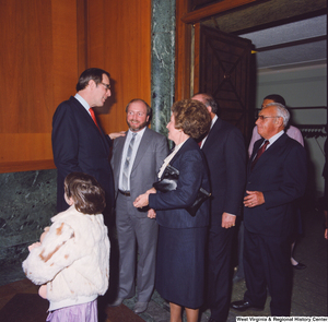 "[""At the Senate Swearing-In Ceremony, Senator John D. (Jay) Rockefeller greets a group of unidentified individuals.""]%"