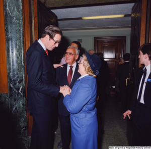 "[""After the Senate Swearing-In Ceremony, Senator John D. (Jay) Rockefeller shakes hands with unidentified supporters.""]%"