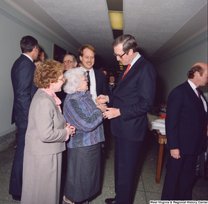 "[""Unidentified supporters speak with Senator John D. (Jay) Rockefeller after the Senate Swearing-In Ceremony.""]%"