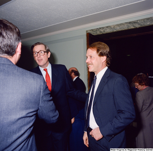 "[""Senator John D. (Jay) Rockefeller speaks with unidentified supporters after his Senate Swearing-In Ceremony.""]%"