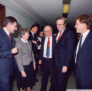 "[""Senator John D. (Jay) Rockefeller and unidentified supporters chat following the Senate Swearing-In Ceremony.""]%"