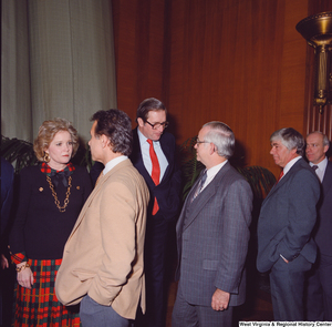 "[""After his Swearing-In Ceremony, Senator John D. (Jay) Rockefeller and his wife Sharon are greeted by unidentified supporters.""]%"