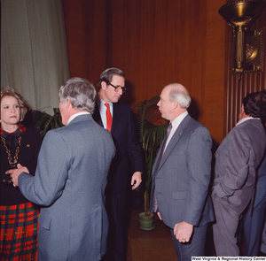 "[""Unidentified supporters speak with Senator John D. (Jay) Rockefeller and Sharon Rockefeller after the Senate Swearing-In Ceremony.""]%"