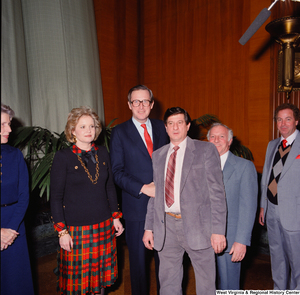 "[""Senator John D. (Jay) Rockefeller, Sharon Rockefeller, and unidentified supporters pose for a photo following the Senate Swearing-In Ceremony.""]%"