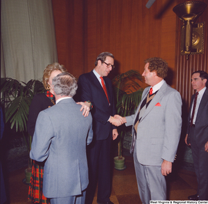 "[""Senator John D. (Jay) Rockefeller and Sharon Rockefeller shake hands with unidentified supporters after the Senate Swearing-In Ceremony.""]%"