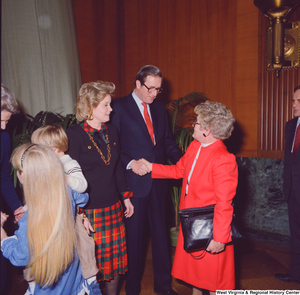 "[""After his swearing-in, Senator John D. (Jay) Rockefeller shakes hands with an unidentified supporter.""]%"