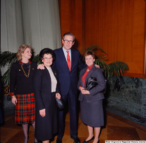 "[""Senator John D. (Jay) Rockefeller, Sharon Rockefeller, and two unidentified supporters pose for a photograph at the Senate Swearing-In Ceremony.""]%"