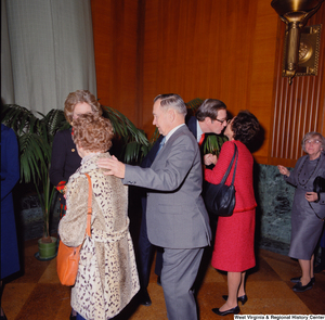 "[""Senator John D. (Jay) Rockefeller and his wife Sharon chat with unidentified supporters at the Senate Swearing-In Ceremony.""]%"