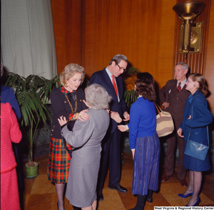 "[""Unidentified supporters greet Senator John D. (Jay) Rockefeller at the Senate Swearing-In Ceremony.""]%"