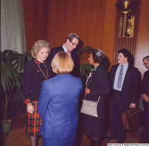 "[""A group of unidentified supporters talk with Senator John D. (Jay) Rockefeller and his wife Sharon at the Senate Swearing-In Ceremony.""]%"