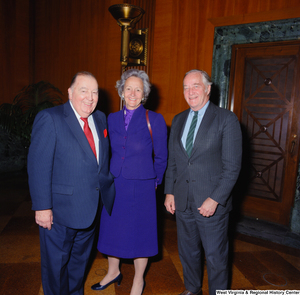"[""Former Senator from West Virginia Jennings Randolph stands with two unidentified individuals at the Senate Swearing-In Ceremony of Senator John D. (Jay) Rockefeller.""]%"