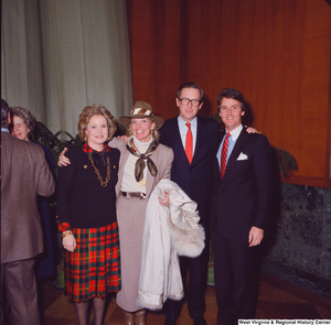 "[""Senator John D. (Jay) Rockefeller, his wife Sharon, and two unidentified supporters pose for a photo at the Senate Swearing-In Ceremony.""]%"