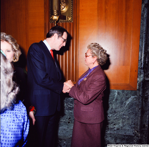 "[""Senator John D. (Jay) Rockefeller shakes hands and speaks with an unidentified supporter at the Senate Swearing-In Ceremony.""]%"