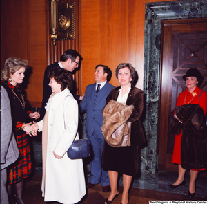 "[""Senator John D. (Jay) Rockefeller greets a group of unidentified supporters at the Senate Swearing-In Ceremony.""]%"