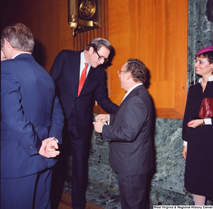"[""Senator John D. (Jay) Rockefeller shakes the hand of an unidentified supporter at the Senate Swearing-In Ceremony.""]%"
